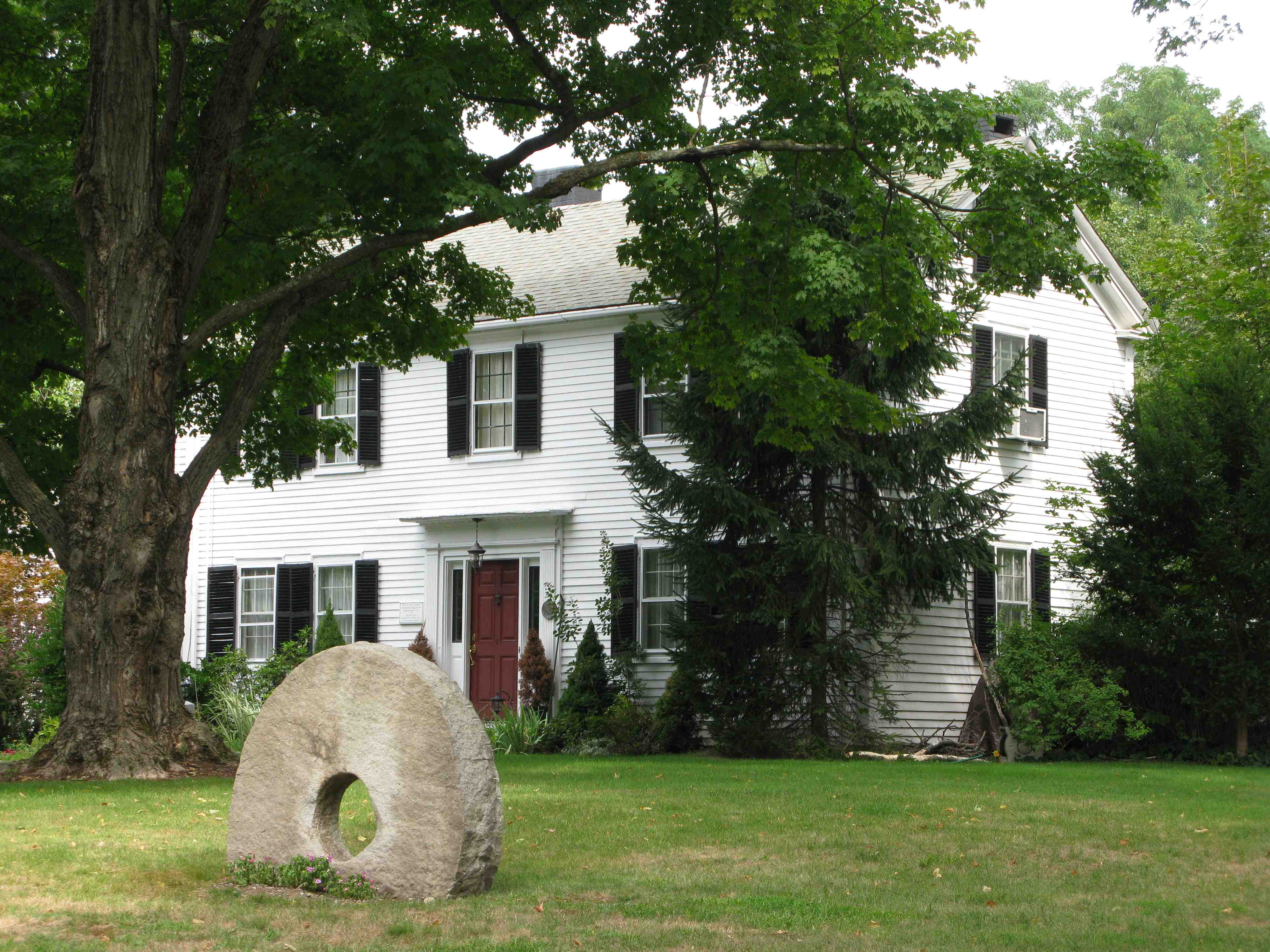 A house at 3 Maple Road, the original farmhouse in the neighborhood