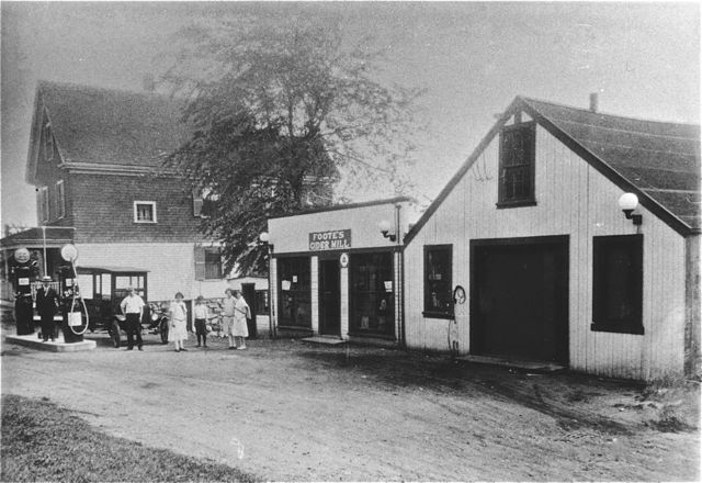 A black and white photo of the Foote's Gas Station