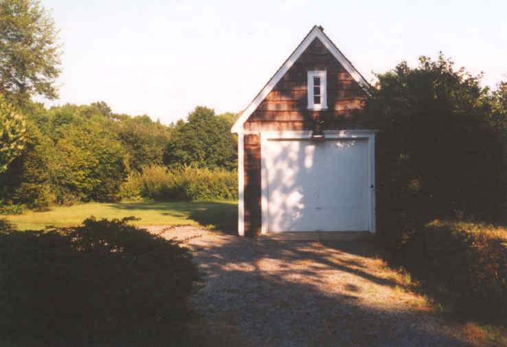 A small outbuilding with garage door